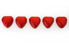 bland annat bana för 3 chokladhjärtor royaltyfria bilder