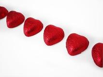 bland annat bana för 4 chokladhjärtor arkivfoto