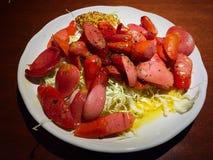 Blandad korvsauté med senap och olivolja Royaltyfri Fotografi