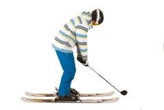 Blandad upp ung man, som inte kan avgöra mellan golf och skidåkning, gyckel Arkivbild