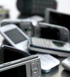blandade blandade mobila telefoner Arkivfoto