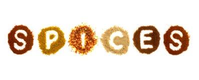 Blandade kryddor som spelling ordkryddorna Arkivfoto