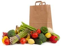 blandade livsmedelsbutiksäckgrönsaker Arkivfoto