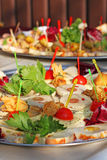blandade matställedeltagareplatår Royaltyfri Fotografi