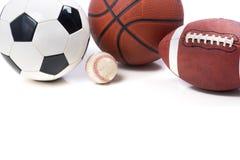 Blandade sportar klumpa ihop sig på vit bakgrund - fotboll, fotboll Royaltyfri Bild