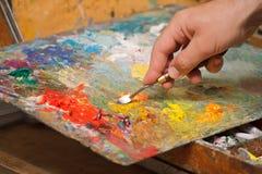 blandande målarfärger Royaltyfria Bilder