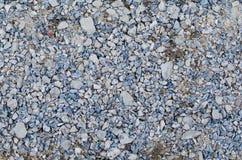 Blandning av grus i blåa vita och gråa färger royaltyfri foto