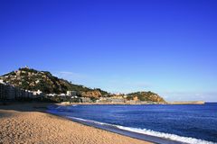 Blanes (Costa Brava, Spain). The beach and Sant Joan mountain at dusk stock photography