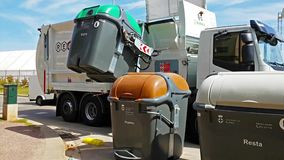 Garbage disposal machine for disposal of waste. Blanes, Spain - 29 may, 2018: Work of garbage disposal machine for disposal of waste from urban containers stock footage