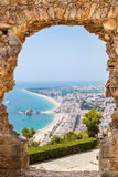 Blanes summertime. View of Blanes through a stone door of the St. John Castle of Blanes in summertime stock photography