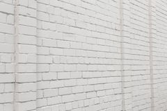 Blank ad space on a white brick wall in the street outside stock image