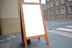 Blank ad space on wooden stand in the street Royalty Free Stock Photos