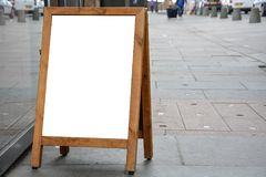 Blank ad space on wooden stand in the street Stock Photos