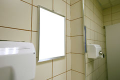 Blank advert in public toilet Royalty Free Stock Photo