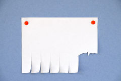 Blank advertisement with cut slips on blue background Royalty Free Stock Photography