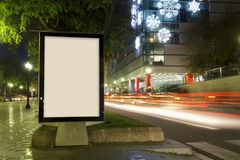 Blank advertisement mock up. With blurred traffic lights at night Stock Photography