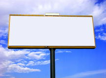 Blank advertising billboard. On blue sky with clouds Royalty Free Stock Photos