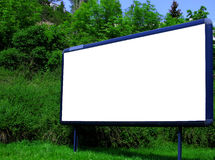 Blank advertising billboard. In urban landscape Royalty Free Stock Photo