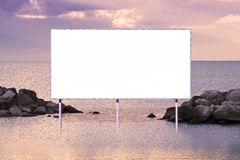 Blank advertising billboard against a seascape background - concept image with copy space.  royalty free illustration