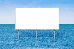 Blank advertising billboard against a seascape background - concept image with copy space.  stock illustration