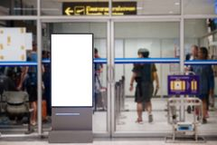 Blank advertising billboard at airport. stock images
