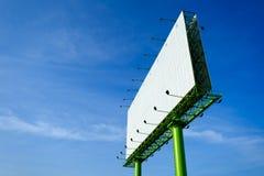 Blank advertising billboard in blue sky Stock Image