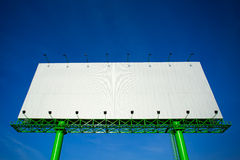 Blank advertising billboard in blue sky Royalty Free Stock Image