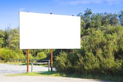 Blank advertising billboard immersed in a rural scene.  royalty free stock images