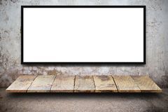 Blank advertising billboard or wide screen television. With old vintage buildings exterior brick wall background, commercial and marketing concept, copy space Royalty Free Stock Photo