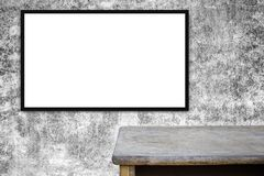 Blank advertising billboard or wide screen television. And wood table with old vintage buildings exterior brick wall background, commercial and marketing Royalty Free Stock Photo