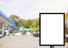 Blank advertising billboard or wide screen television with blurr. Ed gas station background, commercial and marketing concept, copy space for text or media Royalty Free Stock Image