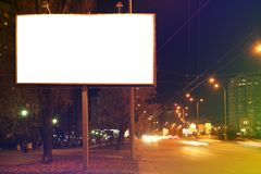Blank advertising board on city street. At night Royalty Free Stock Images