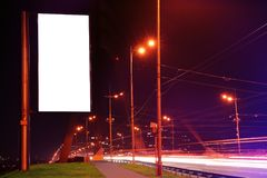 Blank advertising board on city street. At night Royalty Free Stock Photo