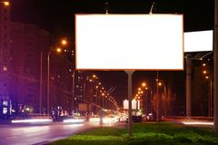 Blank advertising board on city street. At night Stock Image
