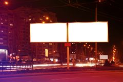 Blank advertising boards on city street. At night Stock Photo