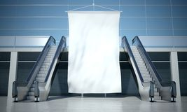 Blank advertising flag and escalator in interior Stock Image