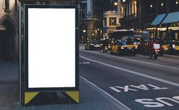 Blank advertising light box on bus stop, mockup of empty ad billboard on night bus station, template banner on background city stock image