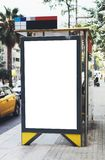 Blank advertising light box on bus stop, mockup of empty ad billboard on night bus station, template banner on background city royalty free stock images