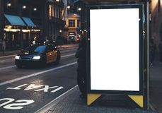 Blank advertising light box on bus stop, mockup of empty ad billboard on night bus station, template banner on background city. Street for message or text in stock photos
