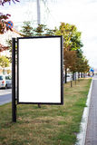 Blank advertising panel in city street Stock Images