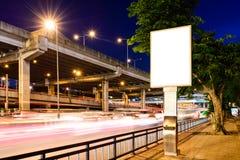 Blank advertising panel near road at night Royalty Free Stock Image