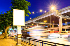 Blank advertising panel near road at night Royalty Free Stock Images