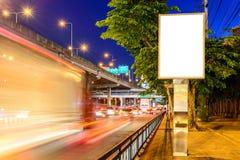 Blank advertising panel near road at night Royalty Free Stock Photo