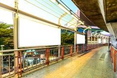 Blank advertising panel at sidewalk in city Stock Photo