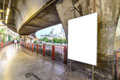 Blank advertising panel at sidewalk in city Stock Photos