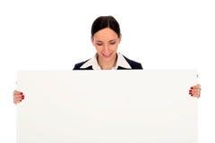 blank affärskvinnaholdingaffisch arkivfoto