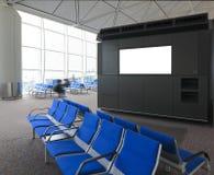 Blank affischtavla och blå stol i flygplats arkivbild