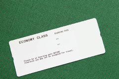 Blank airline boarding pass. On green background Royalty Free Stock Photography