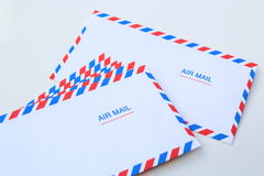 Blank airmail envelope stack. Isolated over white Royalty Free Stock Photos
