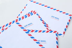 Blank airmail envelope stack. Isolated over white Royalty Free Stock Images